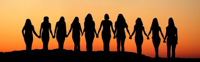 6360246112372341281004896835_cropped-women-holding-hands-sunrise-silhouette